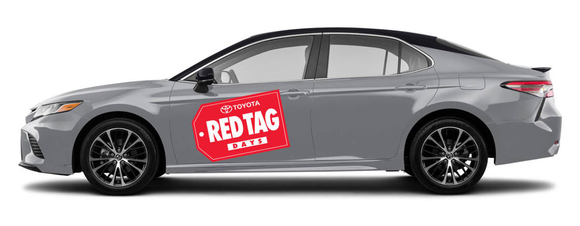 Small Red Tag Days vinyl decal on the side of a 2020 Toyota Camry.